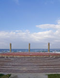 Amphitheater placed on the beach of Mediterranean Sea in Haifa. Outdoor amphitheater placed on the beach of Mediterranean Sea in Haifa, blue sky with clouds Stock Photo