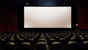 Big silver screen in movie theater with seating. Amphitheater seating and big screen royalty free stock images