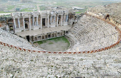 Amphitheatre in ancient ruins of Hierapolis in Turkey Royalty Free Stock Images
