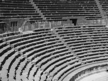 Amphitheatre auditorium, Bosra. Close up of rows of seats and stairway, ancient Roman basalt open amphitheatre, black and white, Bosra, Syria Royalty Free Stock Photo