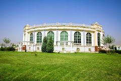 Amphitheatre building in green meadow. Under blue sky Stock Photo