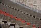 Amphitheatre. Large amphitheatre with brown and red seats Royalty Free Stock Photography