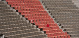 Amphitheatre. Large amphitheatre with brown and red seats Royalty Free Stock Photo
