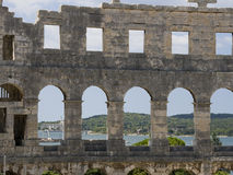 Amphitheatre in Pula, Croatia. One of the best preserved ancient Roman arenas (similar to the famous Colosseum in Rome) in Pula. View on seaside Stock Photos