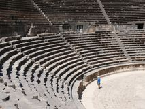 Amphitheatre, rows of seats. Close up of rows of seats and stairway, ancient Roman basalt open amphitheatre, Bosra, Syria Stock Photo