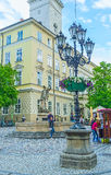 The Amphitrite fountain in Lvov. LVOV, UKRAINE - MAY 16, 2017: The Amphitrite sculpture in fountain next to the City Hall in Old Town with the old-fashioned royalty free stock photography