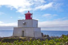 Amphitrite Point Lighthouse located in Ucluelet, Vancouver Island, BC. View of the Amphitrite Point Lighthouse located in Ucluelet, Vancouver Island, BC, Canada royalty free stock photo