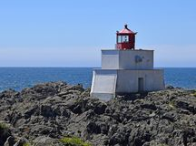 Amphitrite Point Lighthouse, Ucluelet BC. Amphitrite Point Lighthouse overlooking the Barkley Sound , Ucluelet Vancouver Island British Columbia Canada royalty free stock image