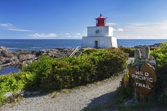 Wild Pacific Trail and Amphitrite Point Lighthouse on Vancouver Island. Amphitrite Point Lighthouse on Wild Pacific Hiking Trail near Ucluelet, Vancouver Island stock images
