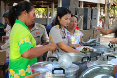 Amphoe Yim Mobile Project. BORABUE, MAHASARAKHAM - NOVEMBER 16 : The unidentified officers are serving lunch in Amphoe Yim Mobile Project on November 16, 2011 at royalty free stock photos
