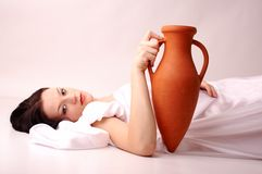 Amphora. Young woman with amphora studio shoot Stock Image