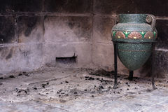 Amphora in the fireplace Stock Images