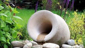 Amphora garden decoration. With flowing water stock video