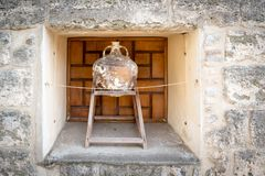 Amphora inside of Castle of St. Peter or Bodrum Castle. Wall for exhibition ,Bodrum,Turkey royalty free stock photos
