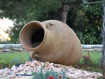 Amphora. Large old amphorae placed in the garden with flowers Royalty Free Stock Images