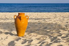 Amphora on the sand. A terracotta amphora on the sandy beach Royalty Free Stock Photos