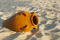 Amphora on the sand. A terracotta amphora on the sandy beach Royalty Free Stock Photo