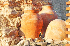 Amphora. Three antique amphoras of clay on the background of the ruins Royalty Free Stock Images