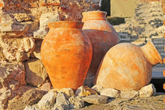 Amphora. Three antique amphoras of clay on the background of the ruins Stock Photography