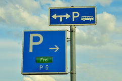 Ample Parking. Blue direction signs for the large parking area Royalty Free Stock Photography