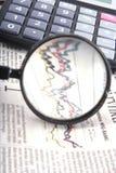 Ampliação sobre o gráfico financeiro Fotografia de Stock