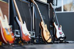 Amplifier with electric guitar on the stage. music instrument set for guitarist. no people royalty free stock image