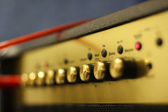 Amplifier. Golden amplifier with a lot of buttons Royalty Free Stock Image