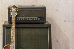 Amplifier and sound effect box with a guitar neck, professional music equipment background royalty free stock photography