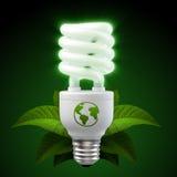 Ampola da economia de energia branca com as folhas no preto Imagem de Stock Royalty Free