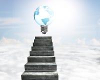 Ampola da forma do globo em escadas concretas Foto de Stock