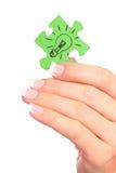 Ampola desenhada terra arrendada da mão no enigma imagens de stock royalty free