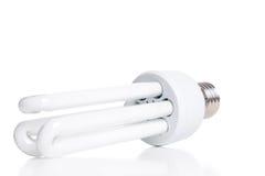 Ampola fluorescente de poupança de energia, isolada no backgrou branco Fotos de Stock Royalty Free