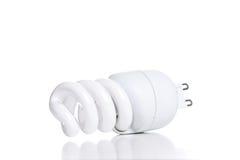 Ampola fluorescente de poupança de energia, isolada no backgrou branco Imagem de Stock