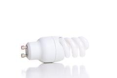 Ampola fluorescente de poupança de energia, isolada no backgrou branco Imagens de Stock