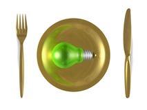 Ampola verde, placa dourada, forquilha e faca. Vista superior ilustração royalty free