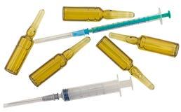 Ampolas para a injeção e as seringas Foto de Stock