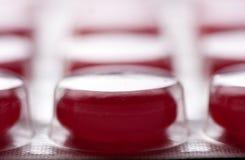 Ampolla de tablillas rojas Foto de archivo libre de regalías