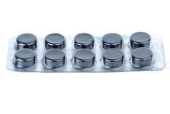 Ampolla llena con las píldoras activadas del carbón Imagen de archivo
