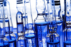 Ampollas con el líquido azul Foto de archivo libre de regalías