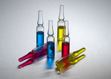Ampolle colorate su acciaio Fotografie Stock