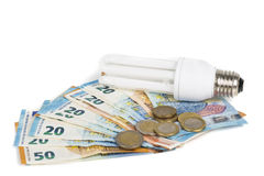 Ampoule économique légère sur les billets de banque européens Images libres de droits
