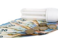 Ampoule économique légère sur les billets de banque européens Photo libre de droits