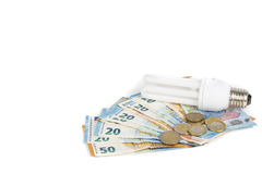 Ampoule économique légère sur les billets de banque européens Image stock
