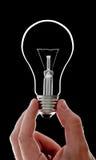 Ampoule électrique à disposition Photo stock
