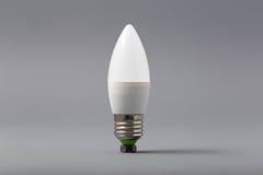 Ampoule électrique sur un fond gris Images stock