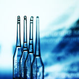 Ampoule. On abstract bokeh background Royalty Free Stock Image