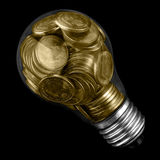 Ampoule avec des pièces de monnaie Photos stock