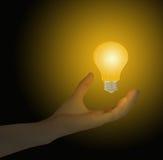 Ampoule avec la main Photographie stock