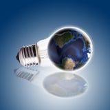 Ampoule avec le fond de gradient de globe, la carte de la terre et le globe bleus Images stock