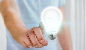 Ampoule brillante émouvante d'homme d'affaires dans son rendu de la main '3D Images stock